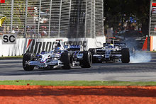 Motorsports Photos - Formula One - Nick Heidfeld and Nico Rosberg on the street circuit of Albert Park in the 2008 Australian Grand Prix.