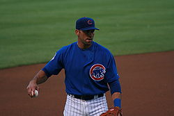 Baseball Photos - Mark Derosa - DeRosa warms up before a game on July 9