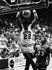 College Basketball Photos - Clyde Drexler - Drexler performs a slam dunk as a member of the Houston Cougars men's basketball team
