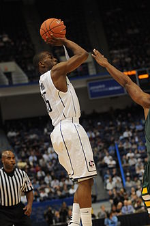 College Basketball Photos - Kemba Walker - Kemba Walker vs UVM on 11-28-2010