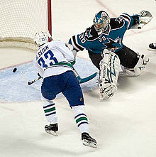 Hockey Photos - Henrik Sedin - Henrik scores against Evgeni Nabokov in 2007%E2%80%9308 NHL season
