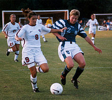Soccer Photos - Mia Hamm - Mia Hamm clashes with Germany 1998.
