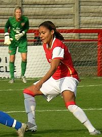 Soccer Photos - Alex Scott (Female Footballer) - Alex Scott playing for Arsenal L.F.C. with Emma Byrne looking on.