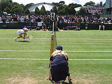 Tennis Photos - Wimbledon Championships - Wimbledon ball girl at the net