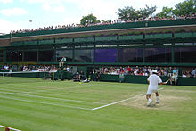 Tennis Photos - Wimbledon Championships - Sébastien Grosjean takes a shot on Court 18 during the 2004 Championships