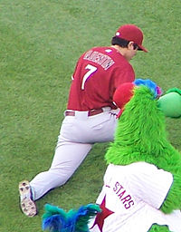 Baseball Photos - Carlos Quentin - Quentin in 2007 on the field with the Phillie Phanatic.