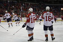 Hockey Photos - Nathan Horton - Horton standing next to teammate Ville Peltonen in 2008%E2%80%9309 NHL season