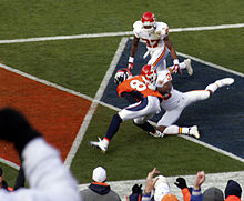 Football Photos - Brandon Lloyd - Lloyd catching a pass for a touchdown against the Kansas City Chiefs on 11-14-2010.
