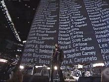 Football Photos - 2002 SUPER BOWL XXXVI - Names of 9/11 victims scroll during U2's performance