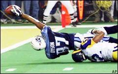 Football Photos - 2000 SUPER BOWL XXXIV - On the final play of Super Bowl XXXIV