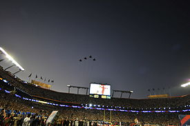 Football Photos - 2010 SUPER BOWL XLIV - Aircraft of the 125th Fighter Wing perform a flyover during the singing of the National Anthem.