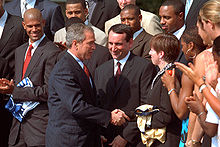 College Basketball Photos - 2001 NCAA Men's Division I Basketball Tournament - President George W. Bush congratulating the 2001 champions from Duke University on the South Lawn of the White House.