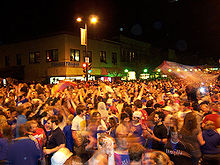 College Basketball Photos - 2008 NCAA Men's Division I Basketball Tournament - KU fans celebrating in downtown Lawrence