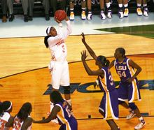 College Basketball Photos - 2008 NCAA Women's Division I Basketball Tournament - Tournament Most Outstanding Player Tennessee forward Candace Parker shoots over Louisiana State center Sylvia Fowles in the national semifinals.