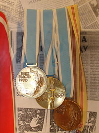 Olympics Photos - 1980 Winter Olympics - Two gold and bronze Olympic medals from XIII Olympic Winter Games