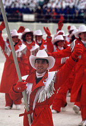 Olympics Photos - 1988 Winter Olympics - Brian Orser carrying the Canadian flag at the opening ceremony