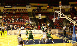 College Basketball Photos - 2006 NAIA Men's Basketball Tournament - Olivet Nazarene Tigers trying to come back to win verses the Oklahoma Baptist Bison.