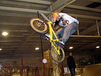 Sports Photos - BMX Bike - Freestyle rider performing a jump based stunt