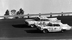 Motorsports Photos - 1959 Daytona 500 - This is decisive moment of the 1959 Daytona 500. Both Mr. Lee Petty and Mr. Johnny Beauchamp are fighting to see who wins the race.