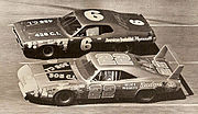Motorsports Photos - 1971 Daytona 500 - This is a picture of a battle going on between Pete Hamilton (in the #6 vehicle) and Dick Brooks (in the #22 vehicle) at the 1971 running of the Daytona 500.