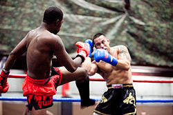 Boxing Photos - Muay Thai - Muay Thai boxer delivering a kick
