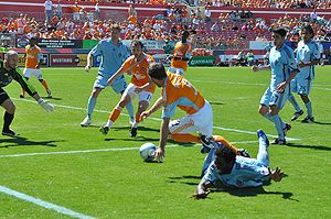 Soccer Photos - Colorado Rapids - The Rapids (in pale blue) in action against Houston Dynamo in 2009