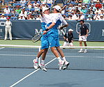 Tennis Photos - 2011 Australian Open - Bob and Mike Bryan won the men's doubles title for the fifth time and achieved a third consecutive title at the event.