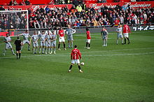 Soccer Photos - Premier League - Cristiano Ronaldo performing a freekick. A 2009 match between Manchester United and Liverpool.