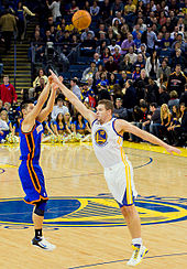 Basketball Photos - Jeremy Lin - Lin shoots over former Warriors teammate David Lee.