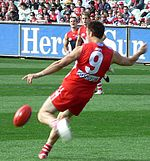 Sports Photos - Australian Rules Football - Precise field and goal kicking using the oval shaped ball is the most important skill in Australian rules.