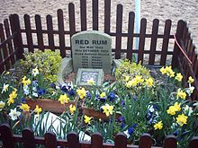 Horse Racing Photos - Red Rum - Red Rum's grave at Aintree