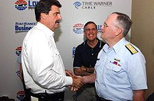 Motorsports Photos - Nascar - NASCAR President Mike Helton (left) being presented a Commandant Coin by Admiral Thomas H. Collins (right) in 2005.