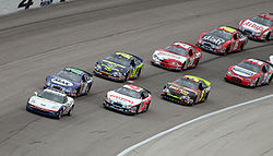 Motorsports Photos - Nationwide Series - The Nationwide Series field following the pace car at Texas in April 2007.
