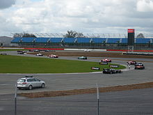 Motorsports Photos - Silverstone Circuit - Formation lap around Brooklands corner at the 2010 Superleague Formula round