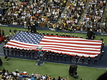 Tennis Photos - 2008 US Open (Tennis) - The American flag being unfurled at the opening ceremony