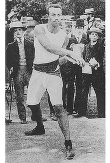 Olympics Photos - 1900 Olympic Games - Rudolf Bauer of Hungary won the discus