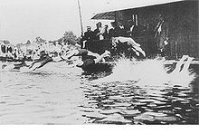 Olympics Photos - 1900 Olympic Games - Swimming race in the river Seine
