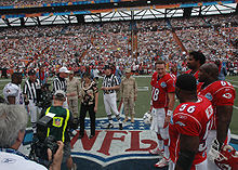 Football Photos - 2006 Pro Bowl - The coin toss before the game with Derrick Brooks (left) representing the NFC and Peyton Manning