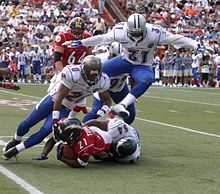 Football Photos - 2006 Pro Bowl - Jeremiah Trotter tackles LaDainian Tomlinson during the game.