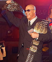 Sports Photos - Kurt Angle - Angle holding IGF's version of the IWGP Heavyweight Championship and the TNA World Heavyweight Championship