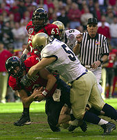College Football Photos - NCAA Football - A college football game between Texas Tech and Navy