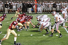 College Football Photos - NCAA Football - A night game between Harvard and Brown