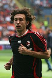 Soccer Photos - Andrea Pirlo - Andrea Pirlo warming up with Milan against Fiorentina