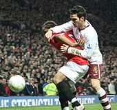 Soccer Photos - Cesc Fabregas - Fàbregas and Anderson of Manchester United in a 2007