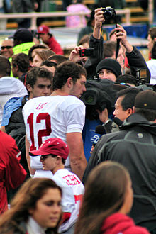 Football Photos - Andrew Luck - Luck being photographed after the Big Game between Stanford and Cal in 2010