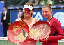 Tennis Photos - Agnieszka Radwanska - Radwanska and Zvonareva following the 2011 Pan Pacific Open final.