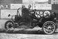 Motorsports Photos - Auto Polo - A malletman balances on the side of a moving auto polo car during a match in 1913 in a photograph by the International News Service.