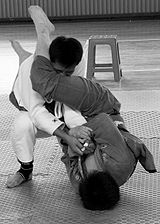 Sports Photos - Brazilian Jiu-Jitsu - A practitioner attempting an Armlock submission