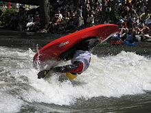 Sports Photos - Whitewater Kayaking - Playboater performing an aerial loop at the Reno whitewater festival.