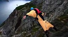 Sports Photos - Base Jumping - Base jumping from a cliff in a wingsuit.
